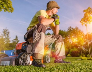 Turf Farm Perth - Lush Green Grass and Lawnmower